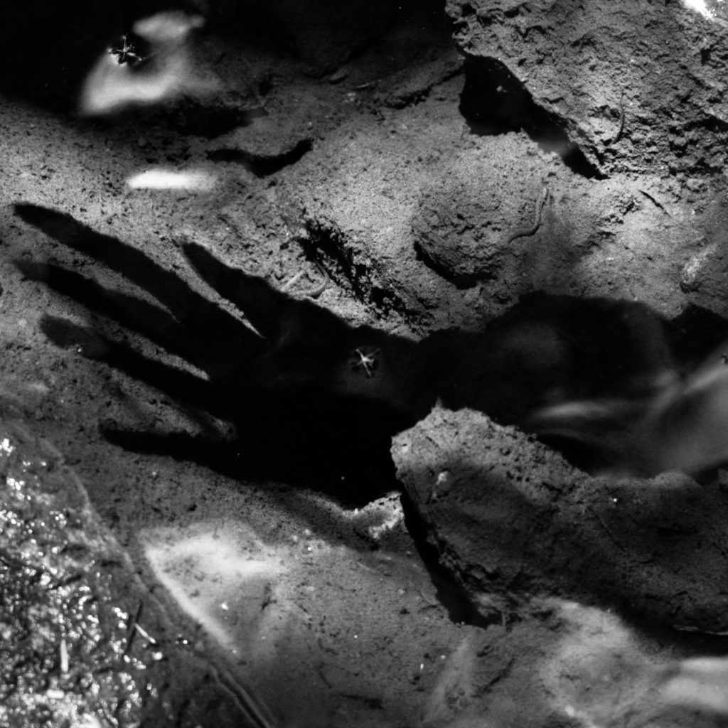 Video still captured of shadow hand appearing to be underwater