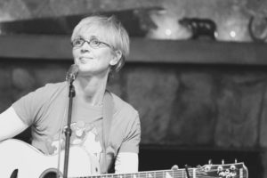 Black and white photo of Kathy Muir performing live