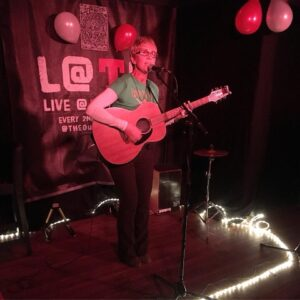 Colour photo of Kathy Muir performing live at The Loft-Songwriter Circle