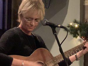 Kathy Muir playing guitar