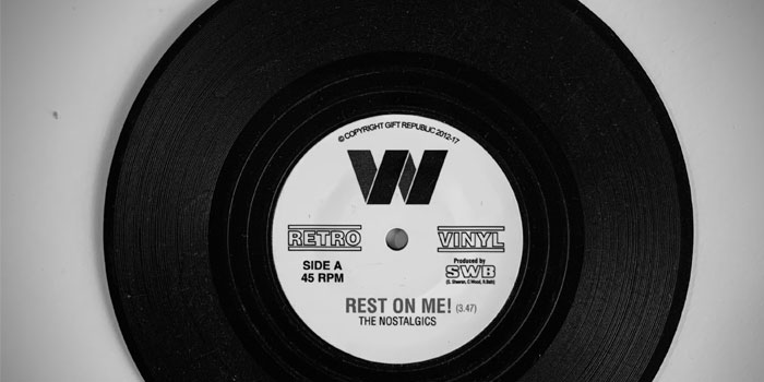 A black and white image of a vinyl record with the title Rest On Me